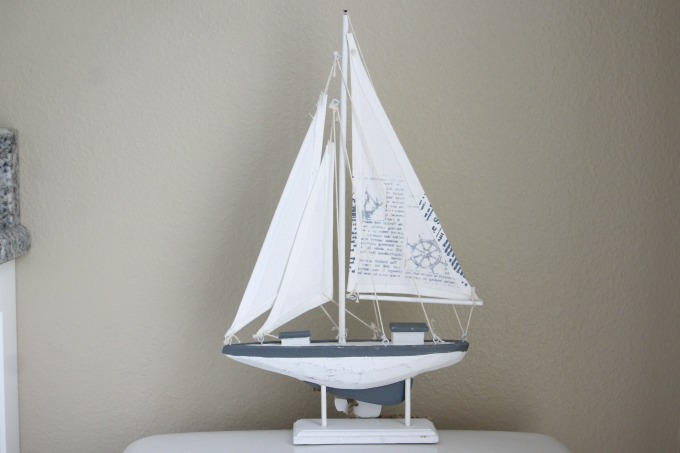 What could be better for a coastal themed bathroom makeover than a sailboat.