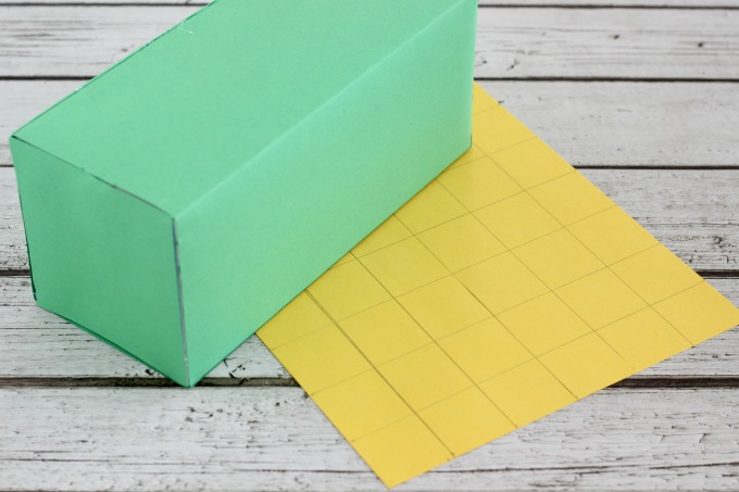 Use yellow construction paper to make the windows of your leprechaun trap.