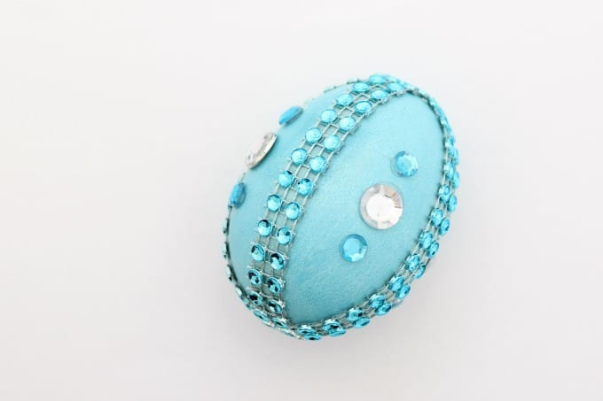 One Easter egg decorating idea is to color an egg blue, then add blue and clear rhinestones