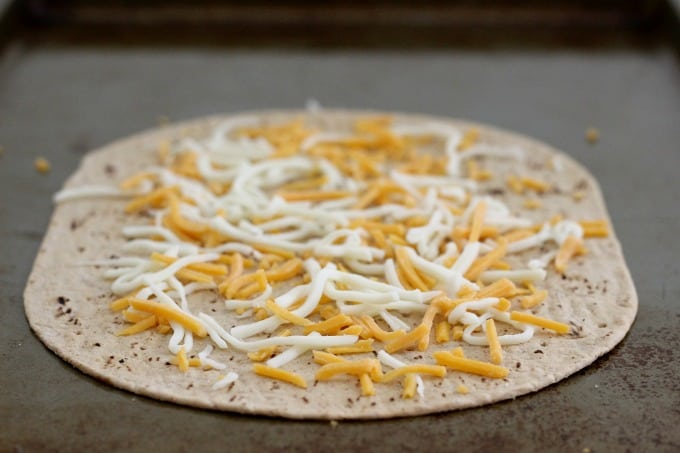 Top the Flatout Flatbread with a little cheese