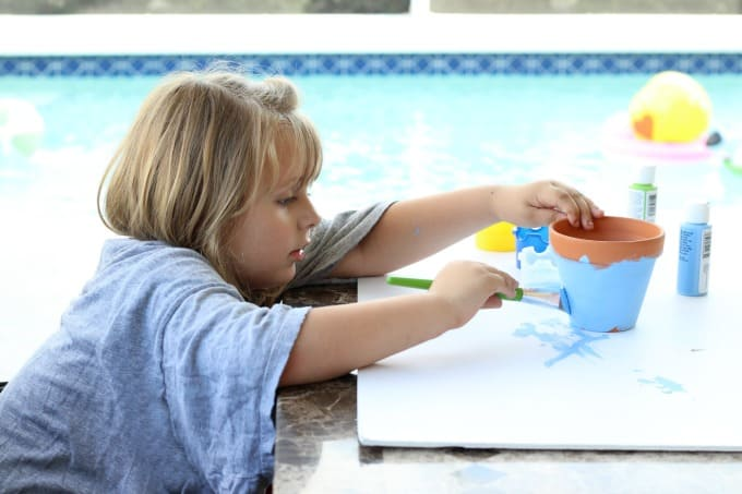 Kids can get as creative as they want with their painted flower pots.