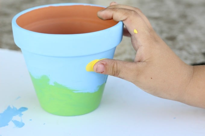 Painting flower pots is easy for kids to do on their own.