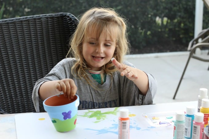 My youngest had a blast making painted flower pots