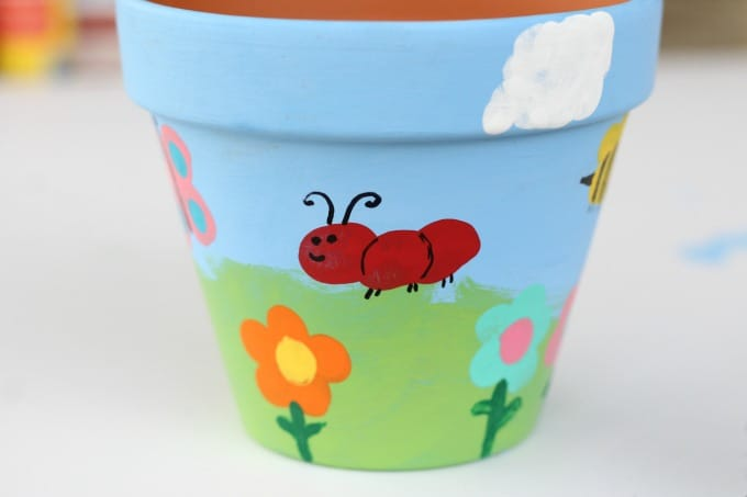 Add any insect or flower you like to these painted flower pots