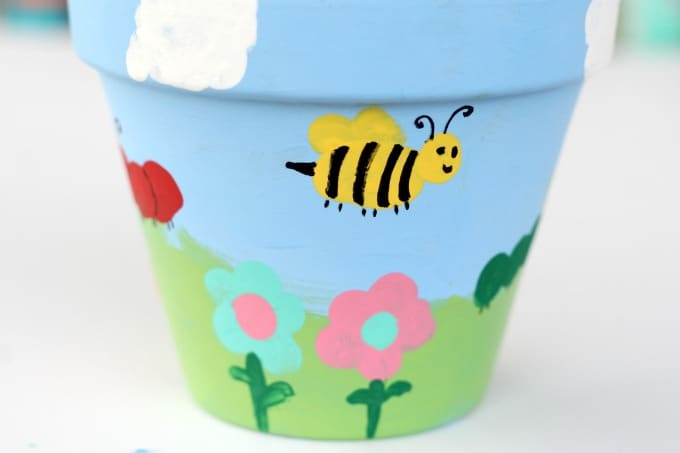 Hand painted flower pots are so easy to make.