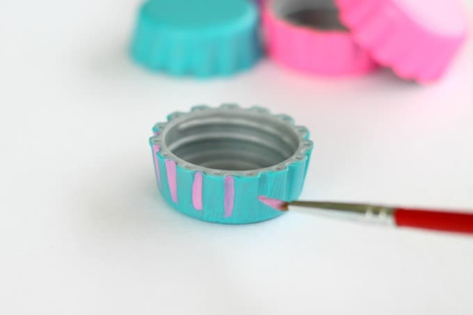 You can choose to leave your bottle cap magnets a solid color or you can add more detail.