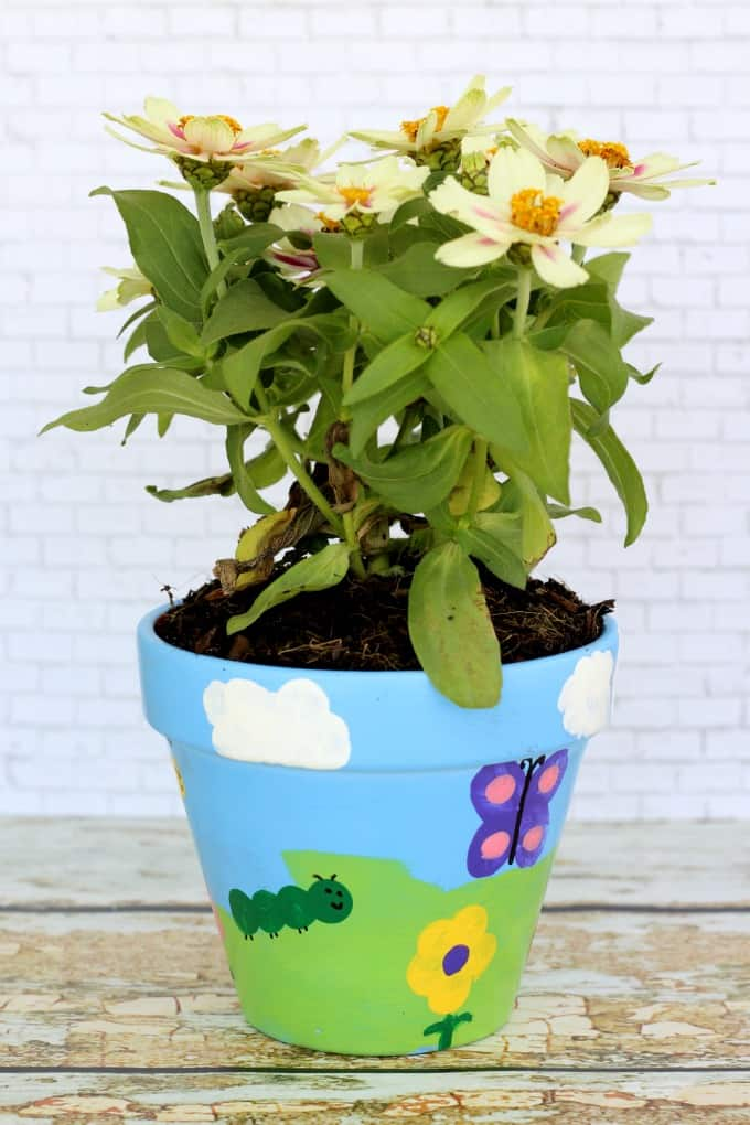 This flower pot painting craft looks different from every angle