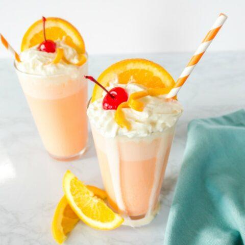 Orange creamsicle milkshakes with garnish