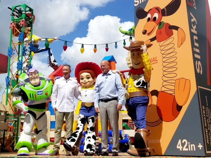 Tim Allen with Buzz, Woody and Jessie at the Toy Story Land opening ceremony