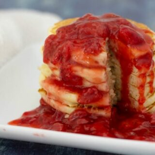 Homemade strawberry syrup on pancakes