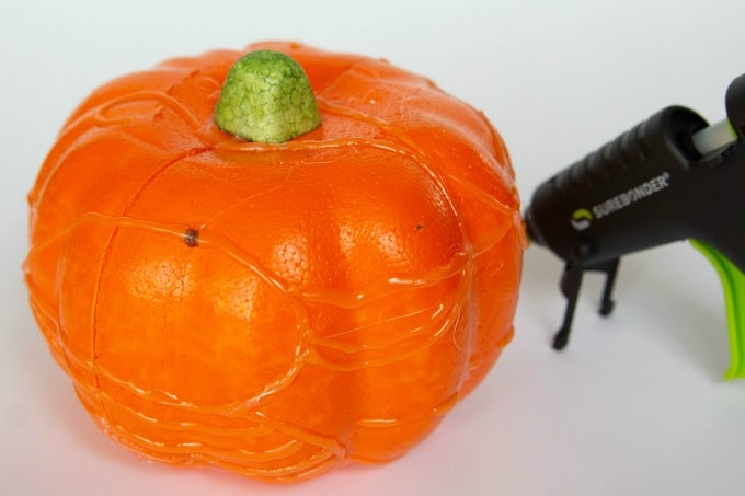 Styrofoam pumpkin with hot glue gun