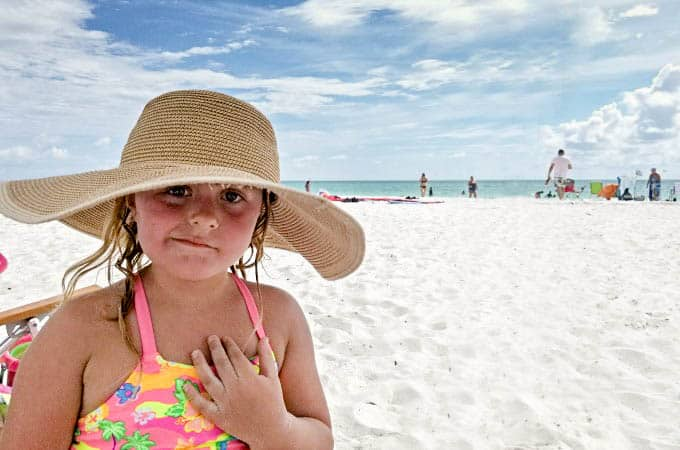 Keira on the beach looking confused