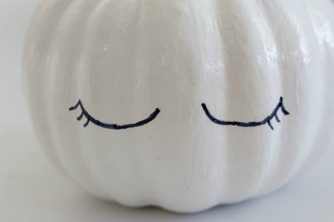Draw eyes on your unicorn pumpkin with black sharpie or paint them on with black paint