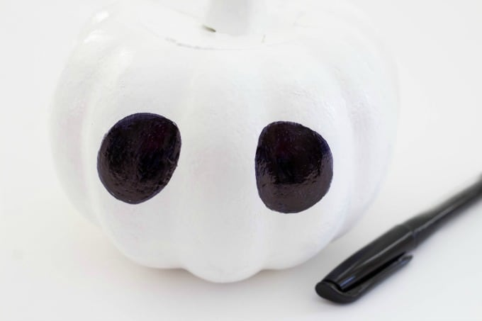 Make the eyes for your Jack Skellington pumpkin with black marker