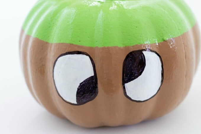 Making silly eyes on the caramel apple pumpkin