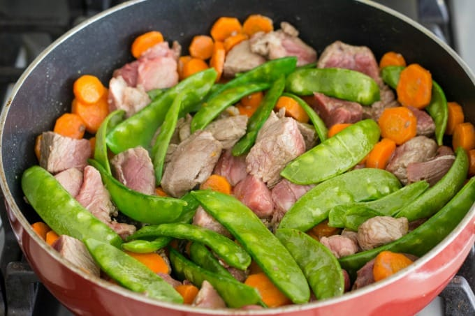 Beef with snow peas and carrots