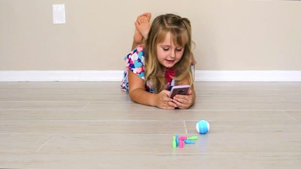 Keira playing with the Sphero Mini