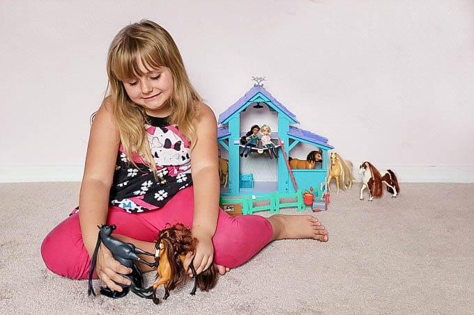 Keira playing with Spirit Riding Free toys