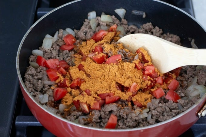 Adding taco seasoning for taco stuffed peppers