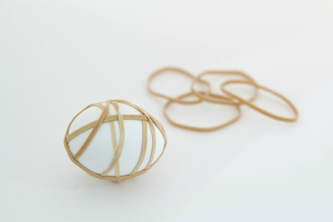 Egg wrapped in rubber bands