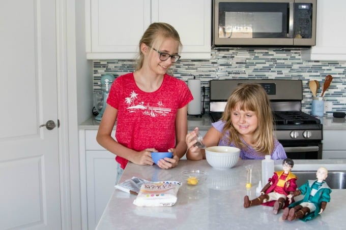 Girls helping in the kitchen