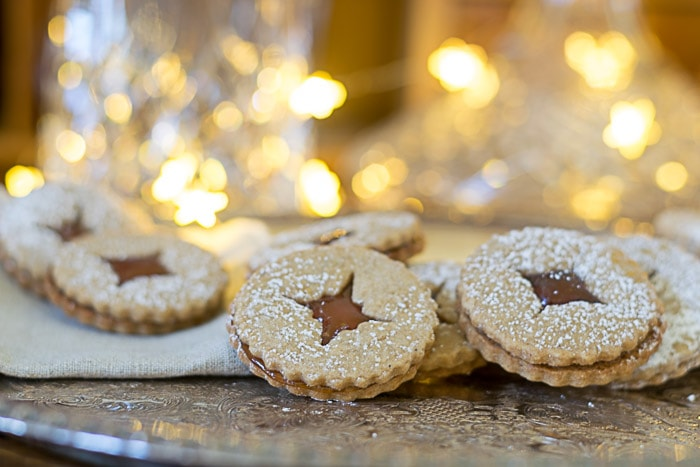 Spiced Linzer Cookie Recipe with Pear Caramel Filling • Nourish and Nestle
