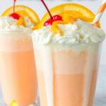Creamsicle milkshakes with cherry and orange