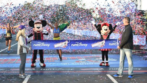 Runner crossing the RunDisney finish line