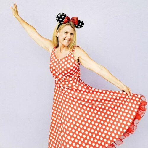 Wearing my Minnie ears at Disney