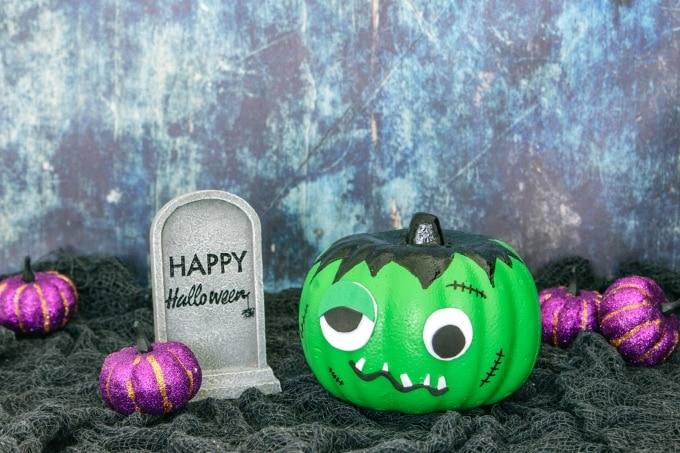 Frankenstein pumpkin with Halloween sign