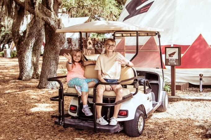 Kids in back of golf cart