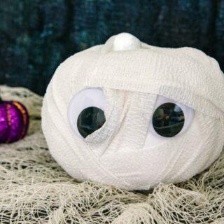 Mummy pumpkin with purple pumpkins