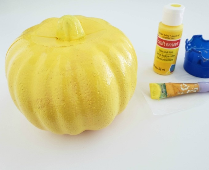Yellow painted pumpkin
