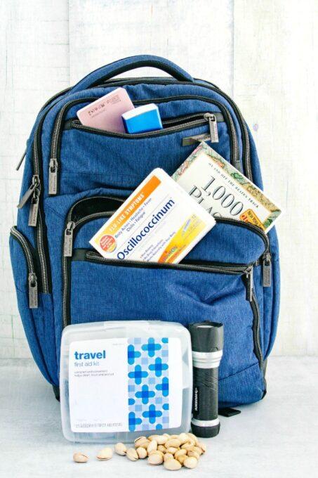 Road trip essentials in bookbag