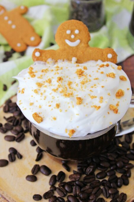 Gingerbread coffee topped with whipped cream and a cookie