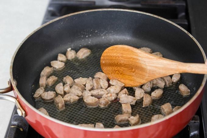 Cooking sausage on stove