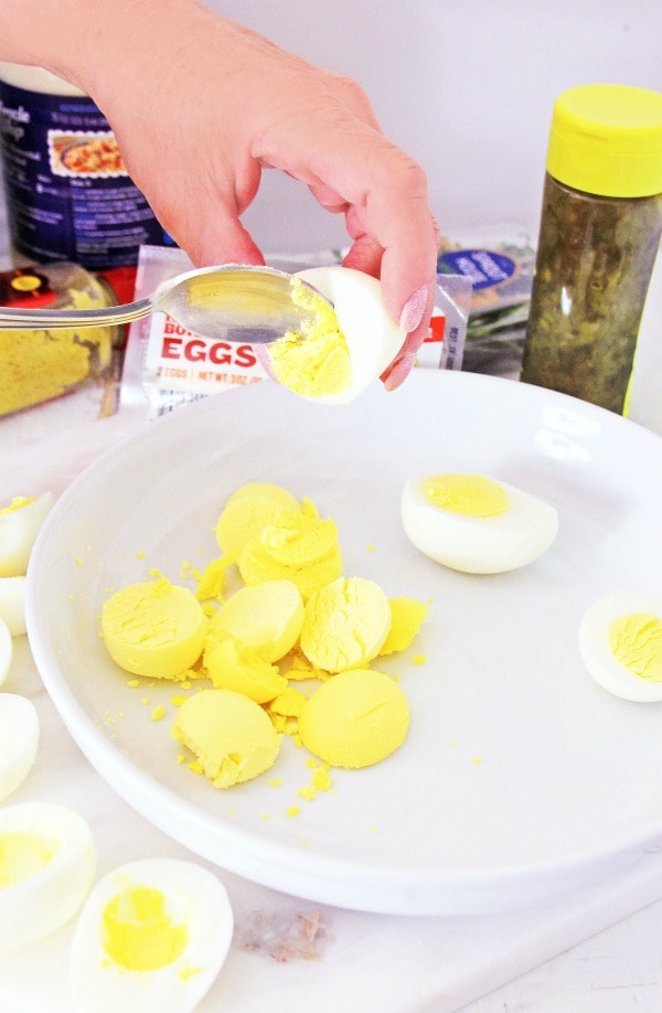 Scooping out yolks for deviled eggs