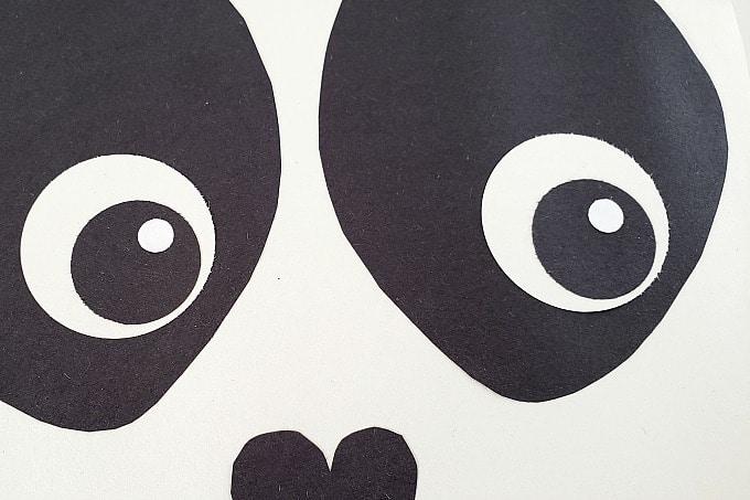White reflection on panda eyes