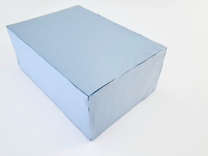 Box with blue construction paper