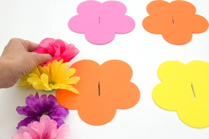 Gluing flowers to foam board for ring toss game