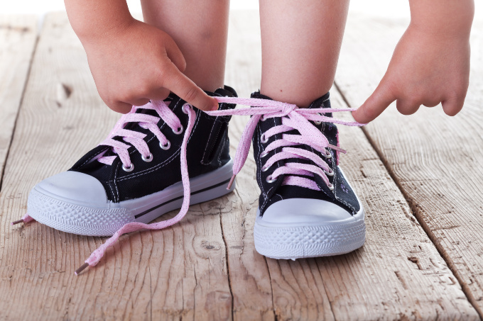 Teach children to tie shoes to get them ready for Kindergarten