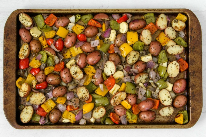 Roasted potatoes and vegetables on baking sheet