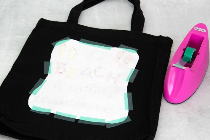 Sublimation marker design taped to tote bag