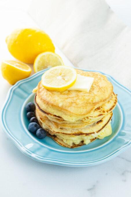 Lemon ricotta pancakes on blue plate