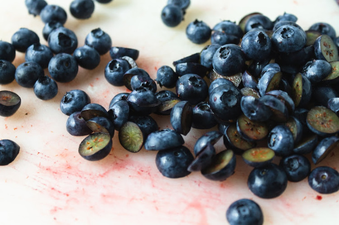 Blueberries cut in half for white wine sangria recipe