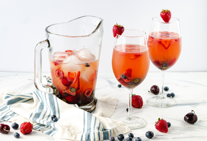 White wine sangria in a pitcher and glassware