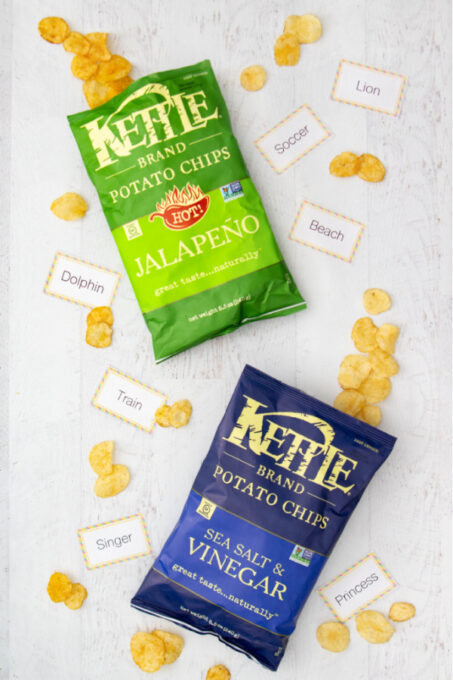 Kettle Potato Chips on table with charades cards