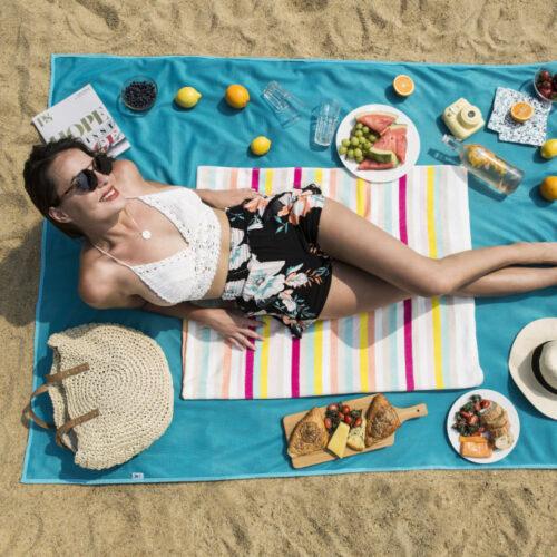 Girl on beach blanket on the sand