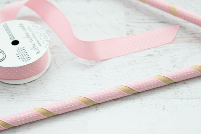 Wooden dowel wrapped in pink ribbon