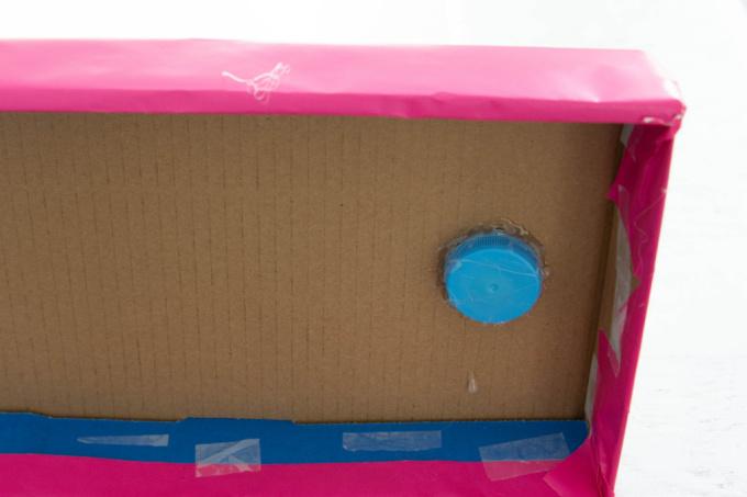 Milk jug lid glued to bottom of box lid